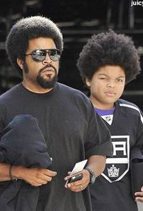 Ice Cube and son - only one is blessed with acting and rap skills, although both have very chubby hands.